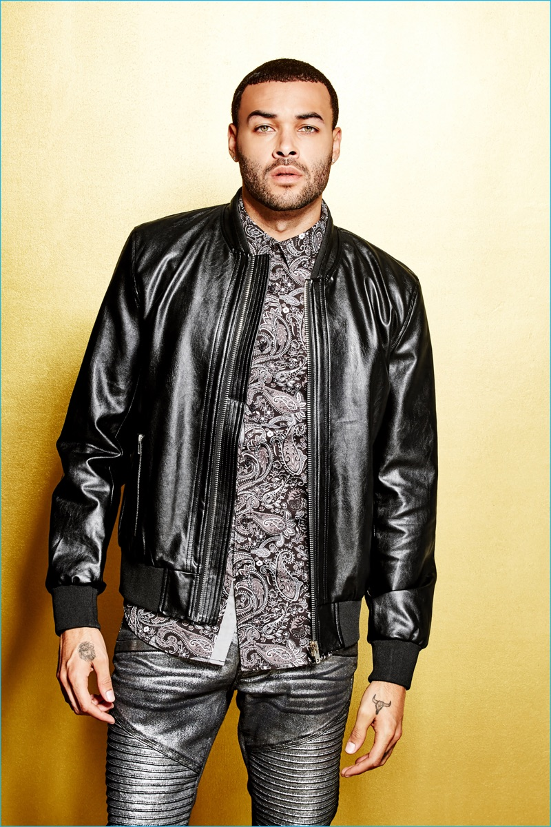 Front and center, Don Benjamin rocks a leather jacket with gold skinny moto jeans, and a paisley print shirt from G by GUESS' Empire collection.