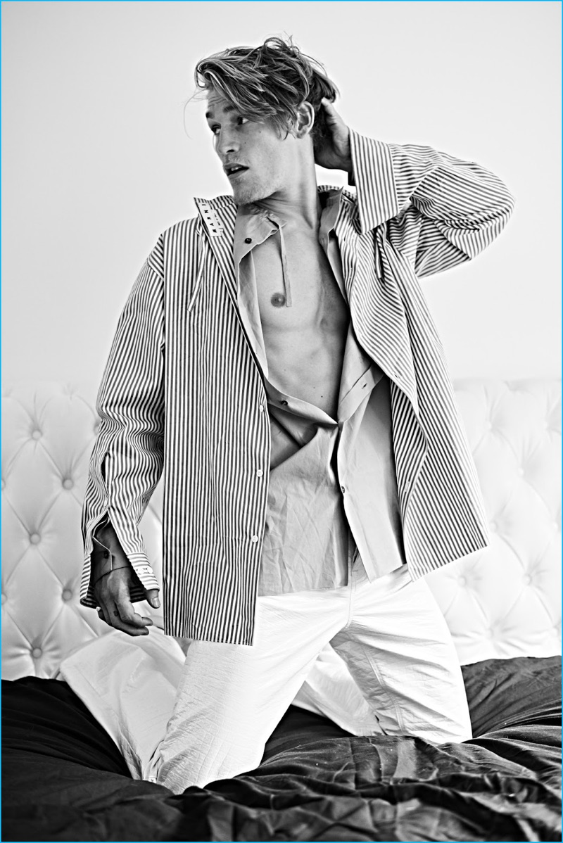 Appearing in an editorial for Seventh Man, Harry Goodwins wears a sailor-inspired top by Prada.
