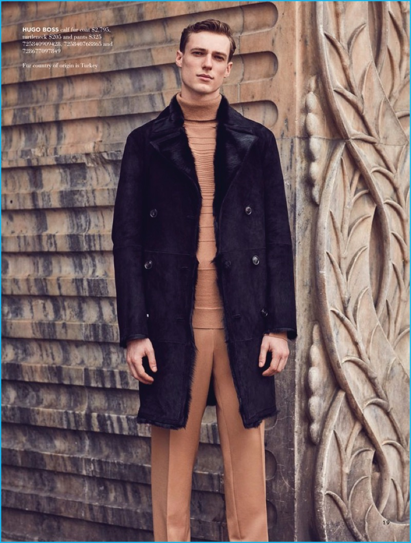 Standing tall, Tommaso de Benedictis dons a brown and black look by Hugo Boss.
