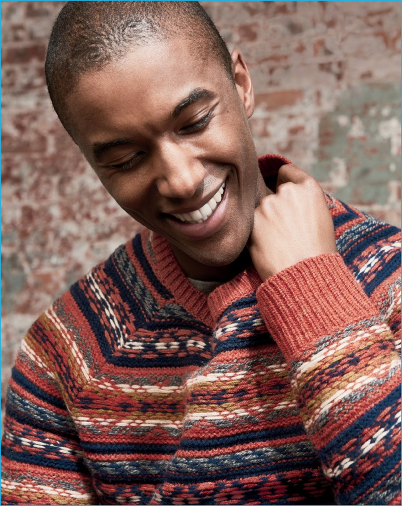 Claudio Monteiro is all smiles in a colorful fair isle sweater from J.Crew.