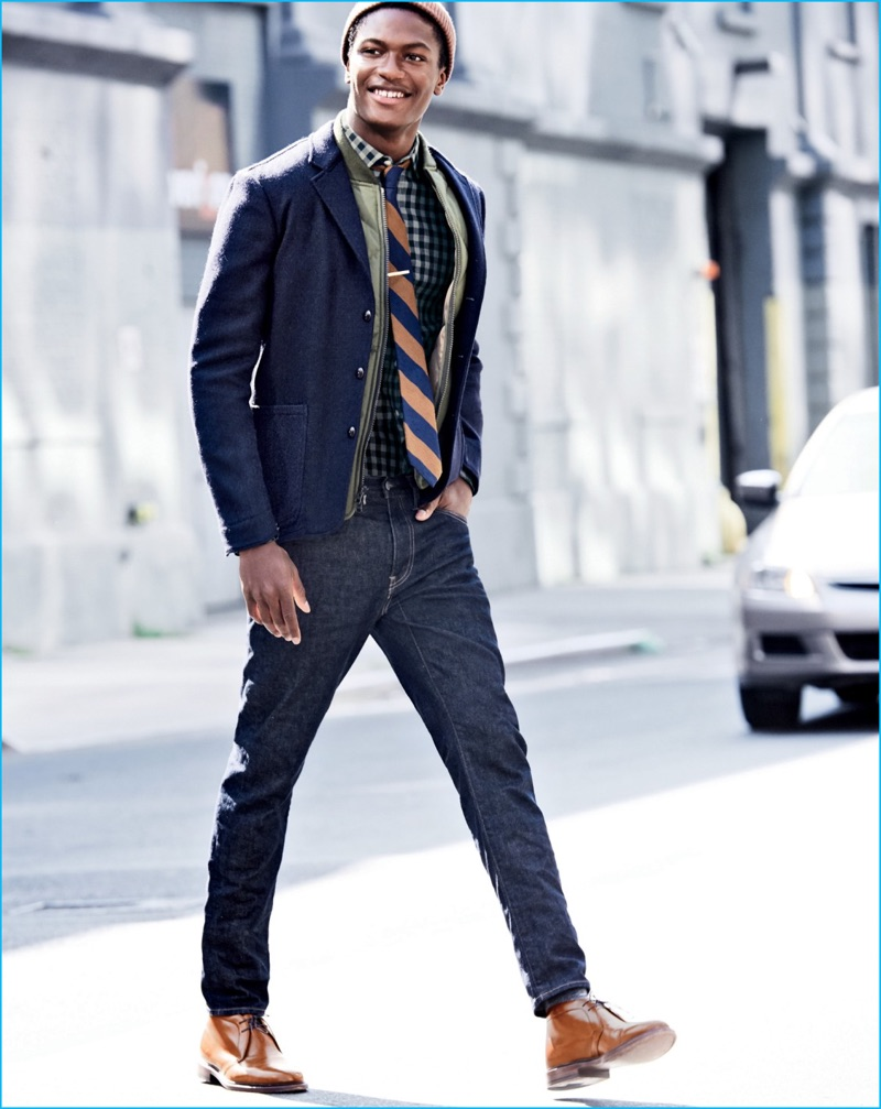 Hamid Onifade layers for the cold in a smart blazer, quilted jacket, and plaid button-down shirt from J.Crew.