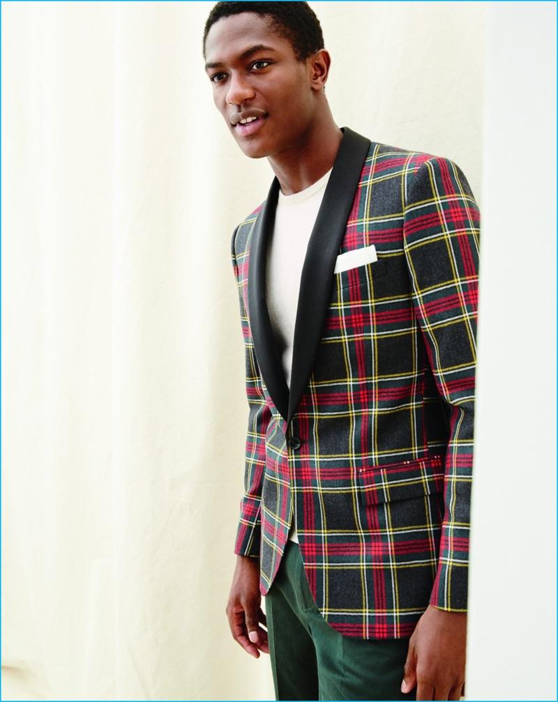 Hamid Onifade models a Ludlow shawl collar plaid print tuxedo jacket from J.Crew.