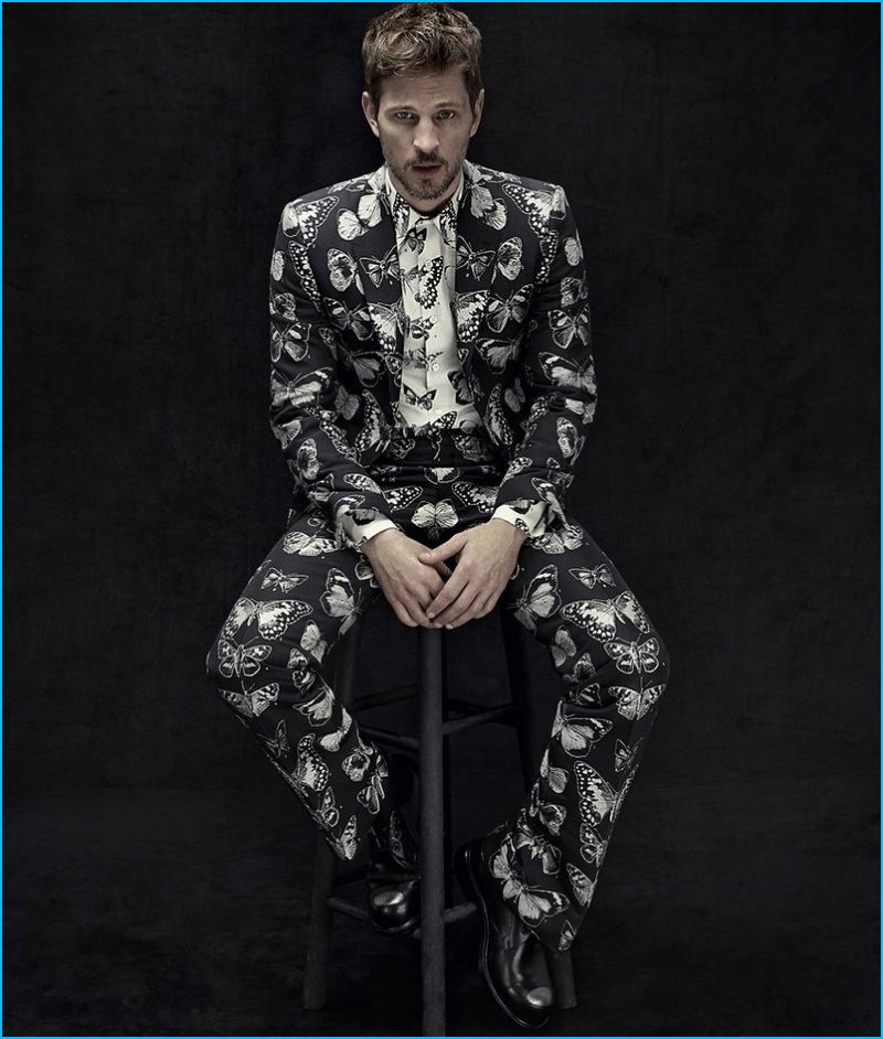 Suiting up with Neiman Marcus, Kelly Rippy wears a butterfly print shirt and suit by Alexander McQueen.
