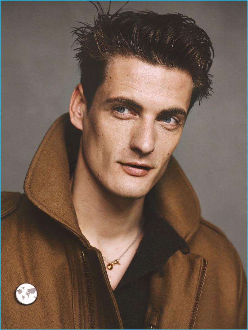 Ben Weller photographs Leo Eller in a Moncler wool coat with a Maison Margiela shirt, and Louis Vuitton accessories.