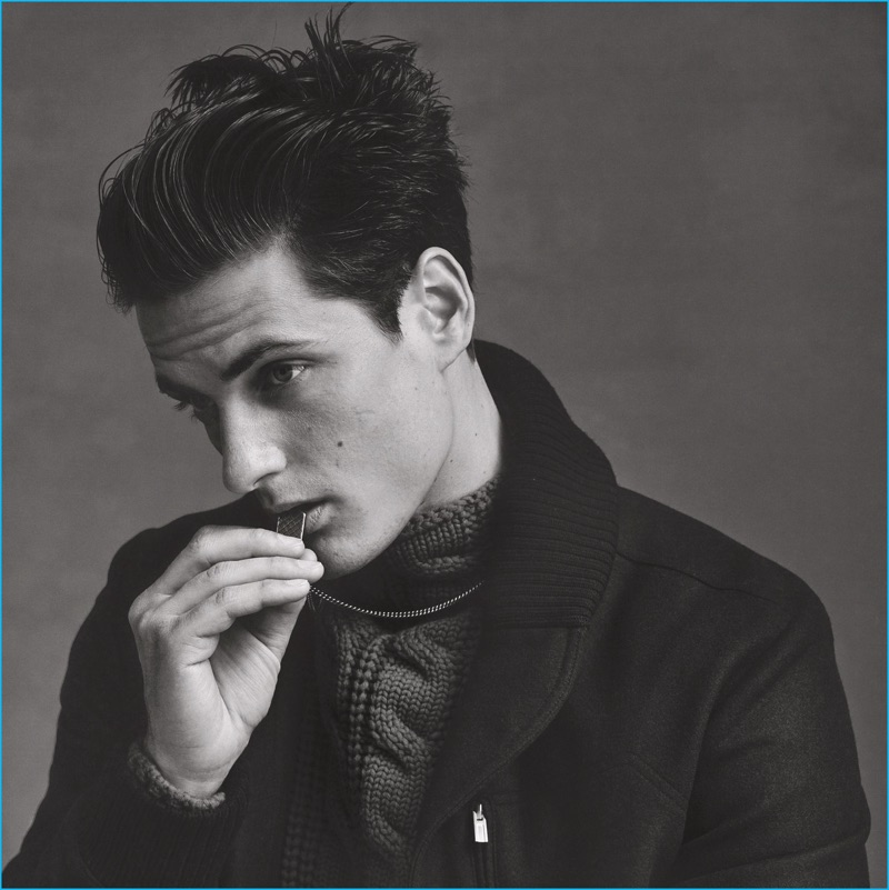 Leo Eller models a wool Hermes coat with a Canali sweater, and Bottega Veneta accessories for SKP magazine.