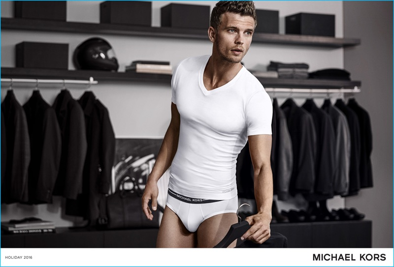 Benjamin Eidem wears a white undershirt and underwear for Michael Kors' holiday 2016 campaign.