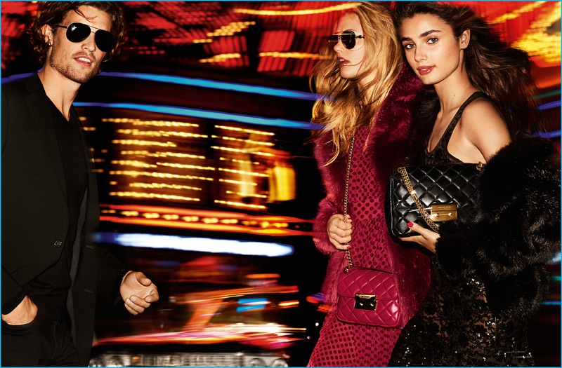 Models Wouter Peelen, Emmy Rappe, and Taylor Hill stars in MICHAEL Michael Kors' holiday 2016 campaign.