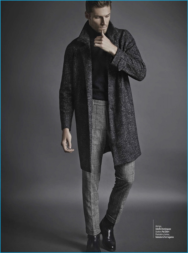 Latvian model Mikus Lasmanis wears an Adolfo Dominguez coat with a Pal Zileri sweater. The top model also sports trousers and leather boots by Salvatore Ferragamo.