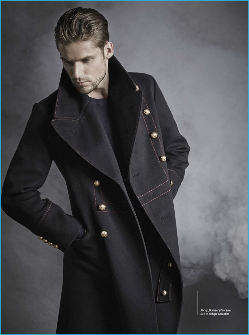 Fernando Carrillo outfits Mikus Lasmanis in a military style coat by Burberry with a Tommy Hilfiger sweater.