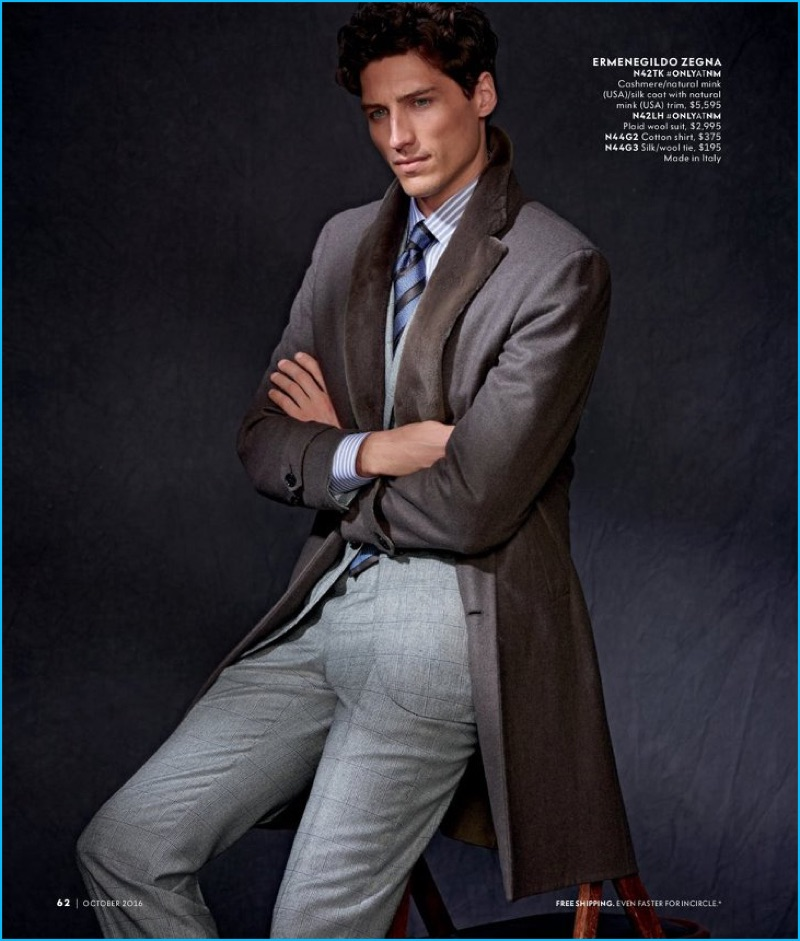 Ryan Kennedy dons a cashmere, mink, and silk coat with a wool suit by Ermenegildo Zegna.