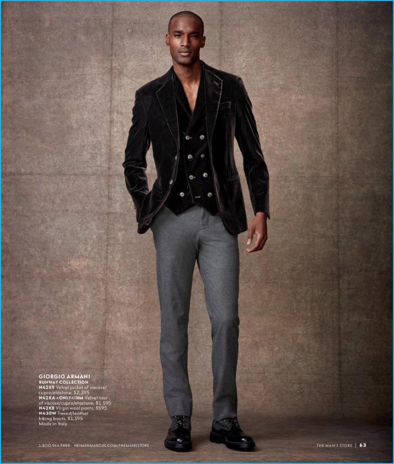 Corey Baptiste sports a velvet waistcoat and blazer with wool pants from Giorgio Armani.