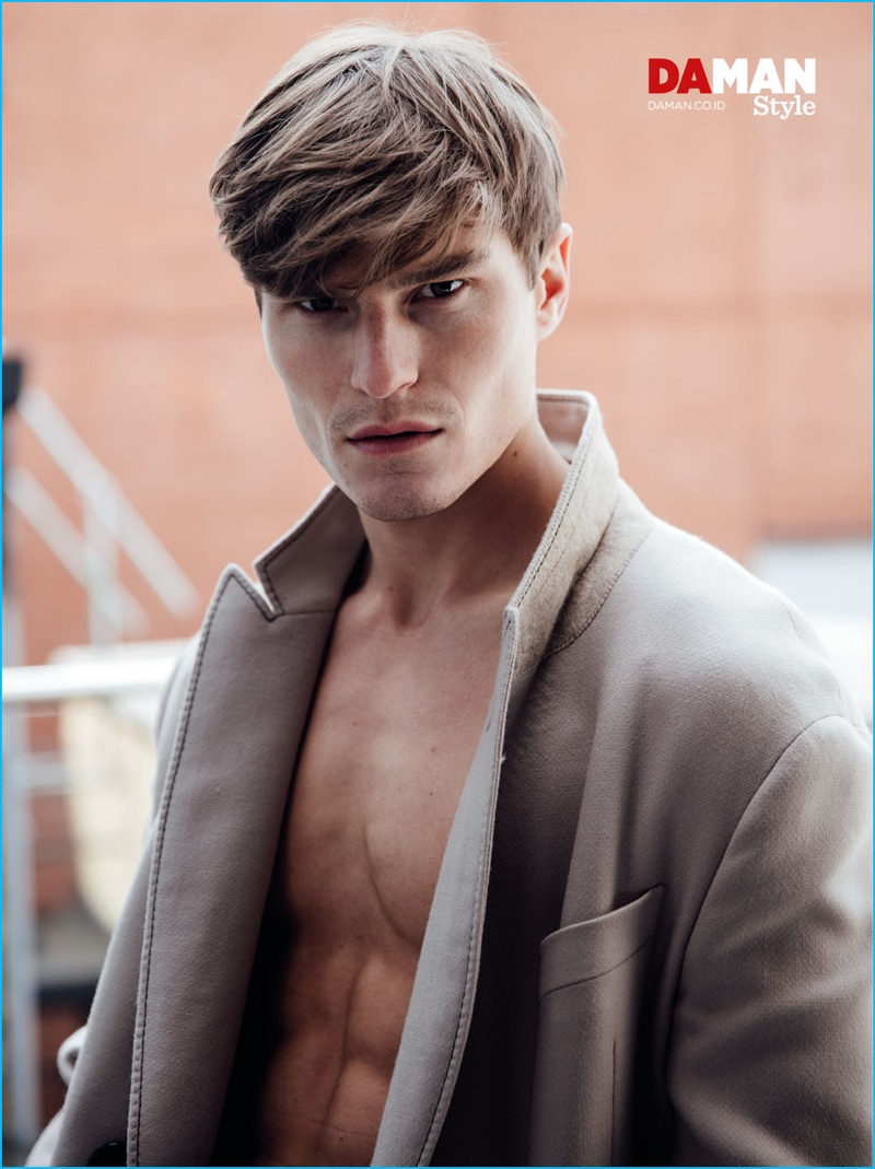 Appearing in a photo shoot for Da Man Style, Oliver Cheshire sports a Lanvin coat.