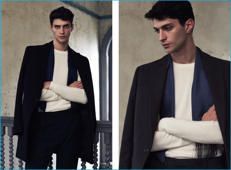 A sleek vision, Matthew Bell wears Reiss' Duke peak lapel coat in black with a Hampton cashmere sweater, Belboy slim moleskin trousers, and a Tallo skinny silk scarf.