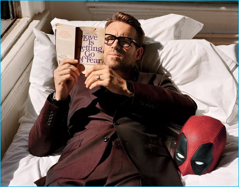 Actor Ryan Reynolds wears a shirt and suit by Dolce & Gabbana. Reynolds also dons a Piaget watch and Tom Ford black framed glasses.