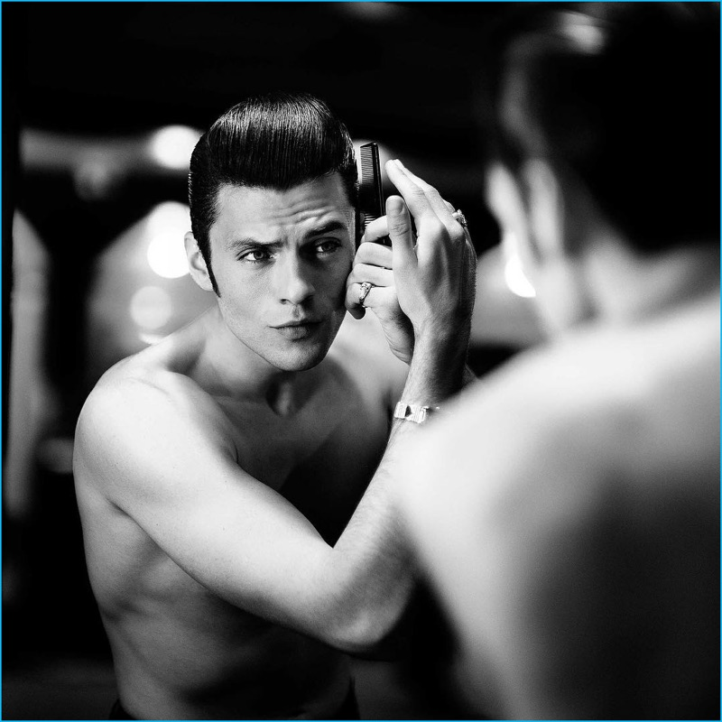 Silviu Tolu primps and preens in front of the mirror, perfecting his pompadour.
