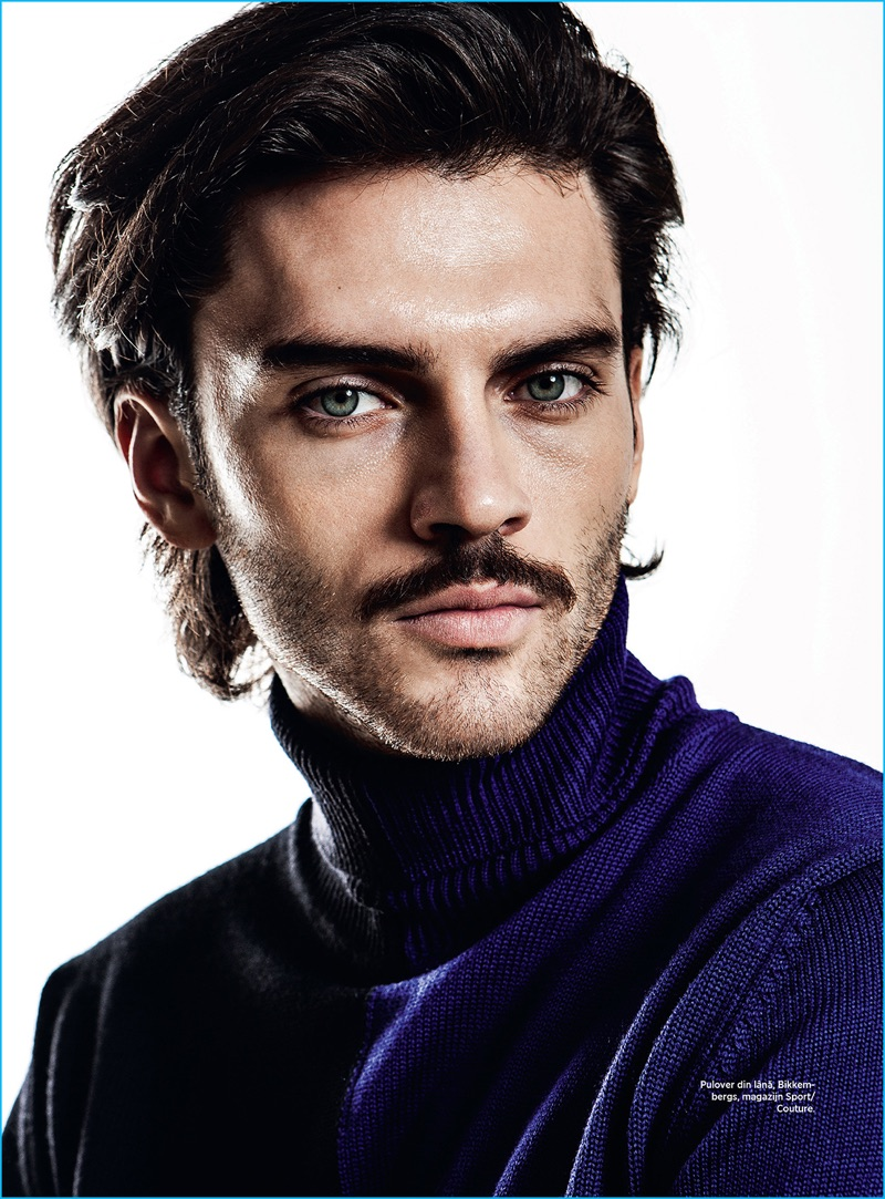 Ready for his close-up, Silviu Tolu sports a Bikkembergs turtleneck sweater.