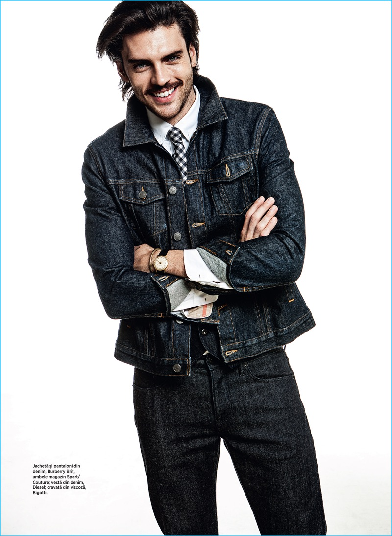 All smiles, Silviu Tolu dons denim fashions from Burberry and Diesel.