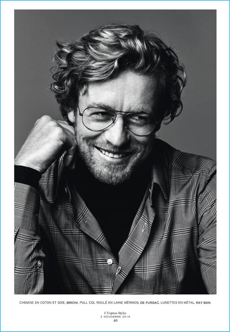 Wearing Ray-Ban glasses and a smile, Simon Baker sports a check shirt from Brioni with a De Fursac turtleneck.