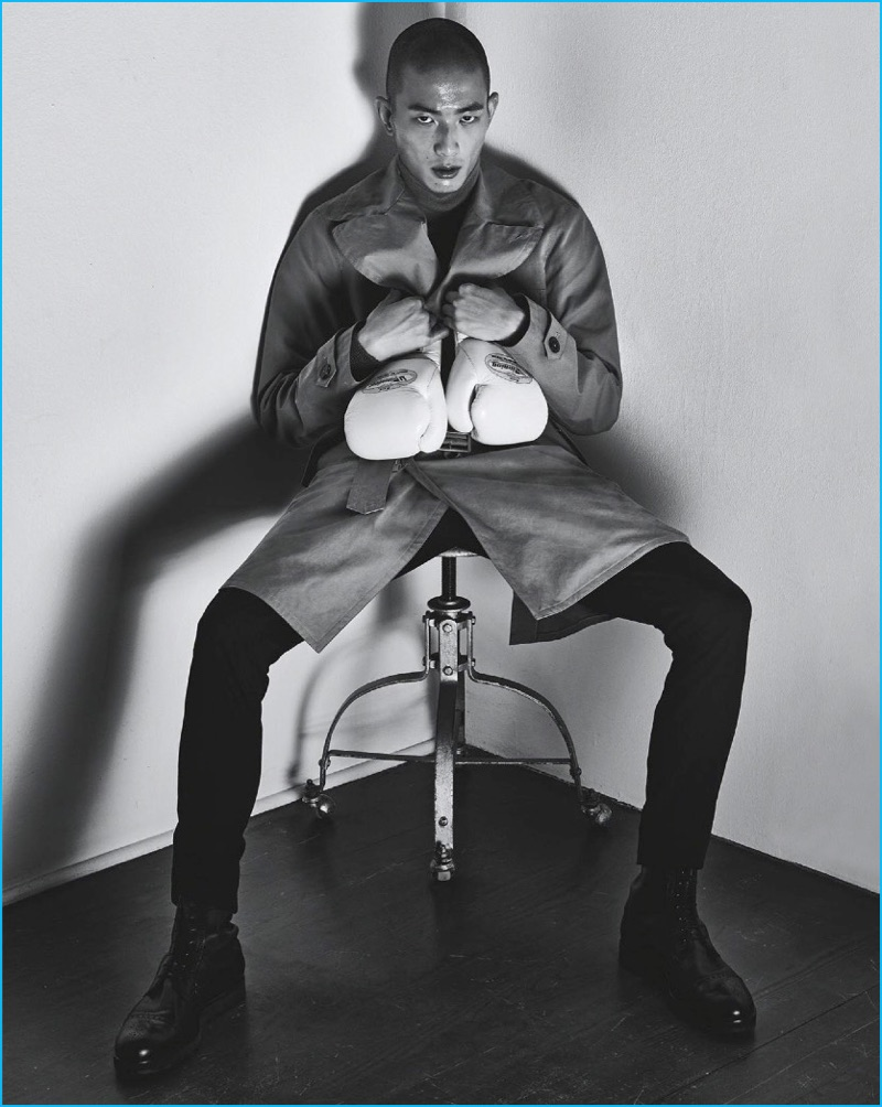 Front and center, Sung Jin Park models a brown coat with a navy suit, wool sweater, and black leather boots from Hermès.