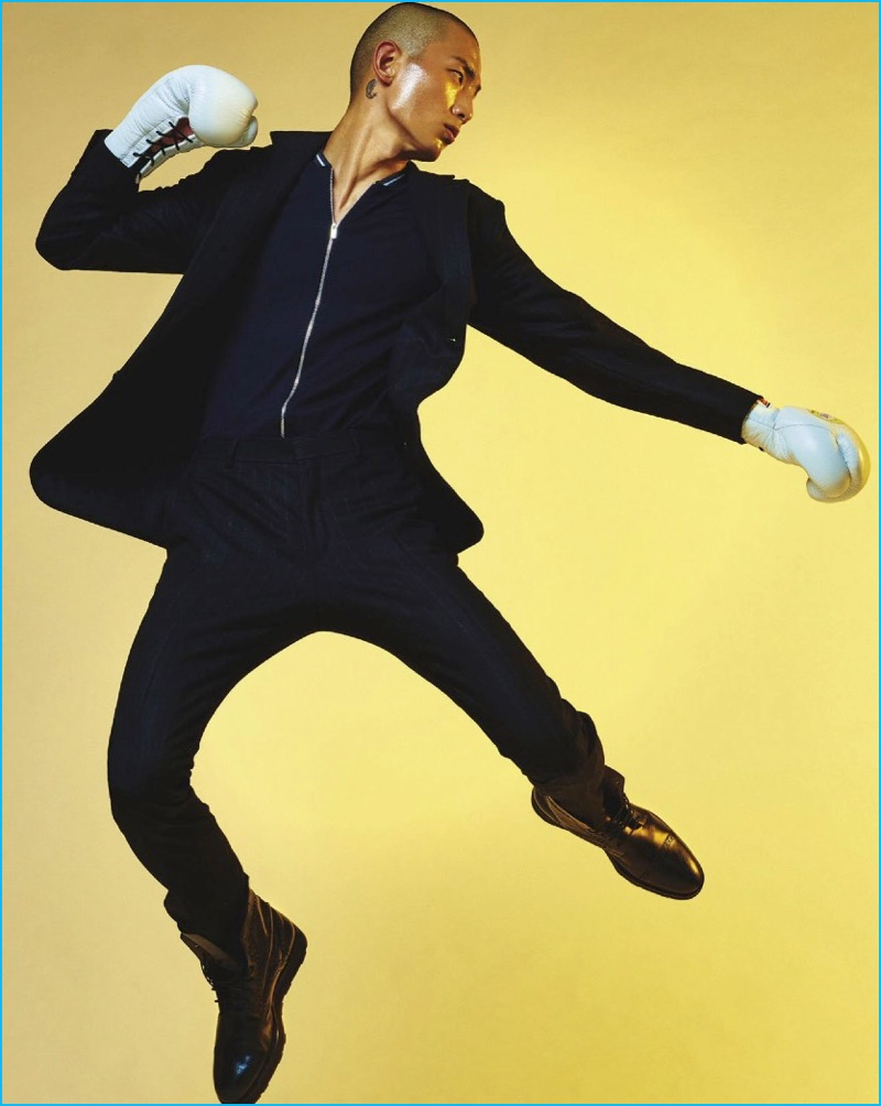 Korean model Sung Jin Park plays a boxer in a wool suit, cashmere-silk jacket, and leather boots by Hermès.