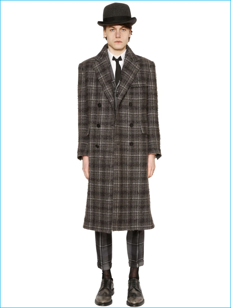 Thom Browne's plaid wool and mohair boucle coat styled with a hat and slim-cut trousers.