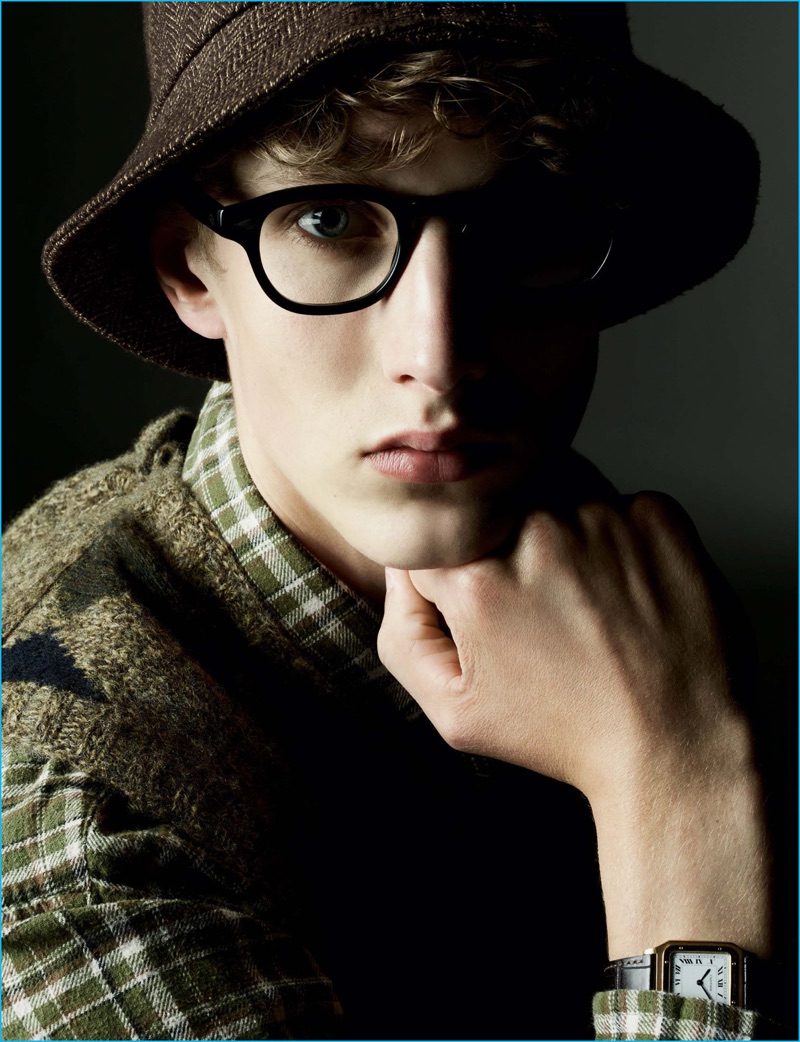 Ellis Kennedy is geek chic in a Polo Ralph Lauren shirt and v-neck sweater. The model also wears a vintage wool hat and Moscot glasses.