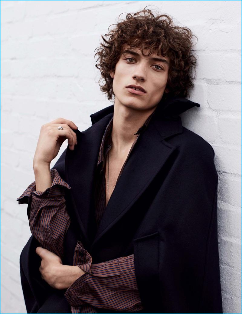 Serge Rigvava models a Prada cape and shirt for Vogue Hommes Paris.