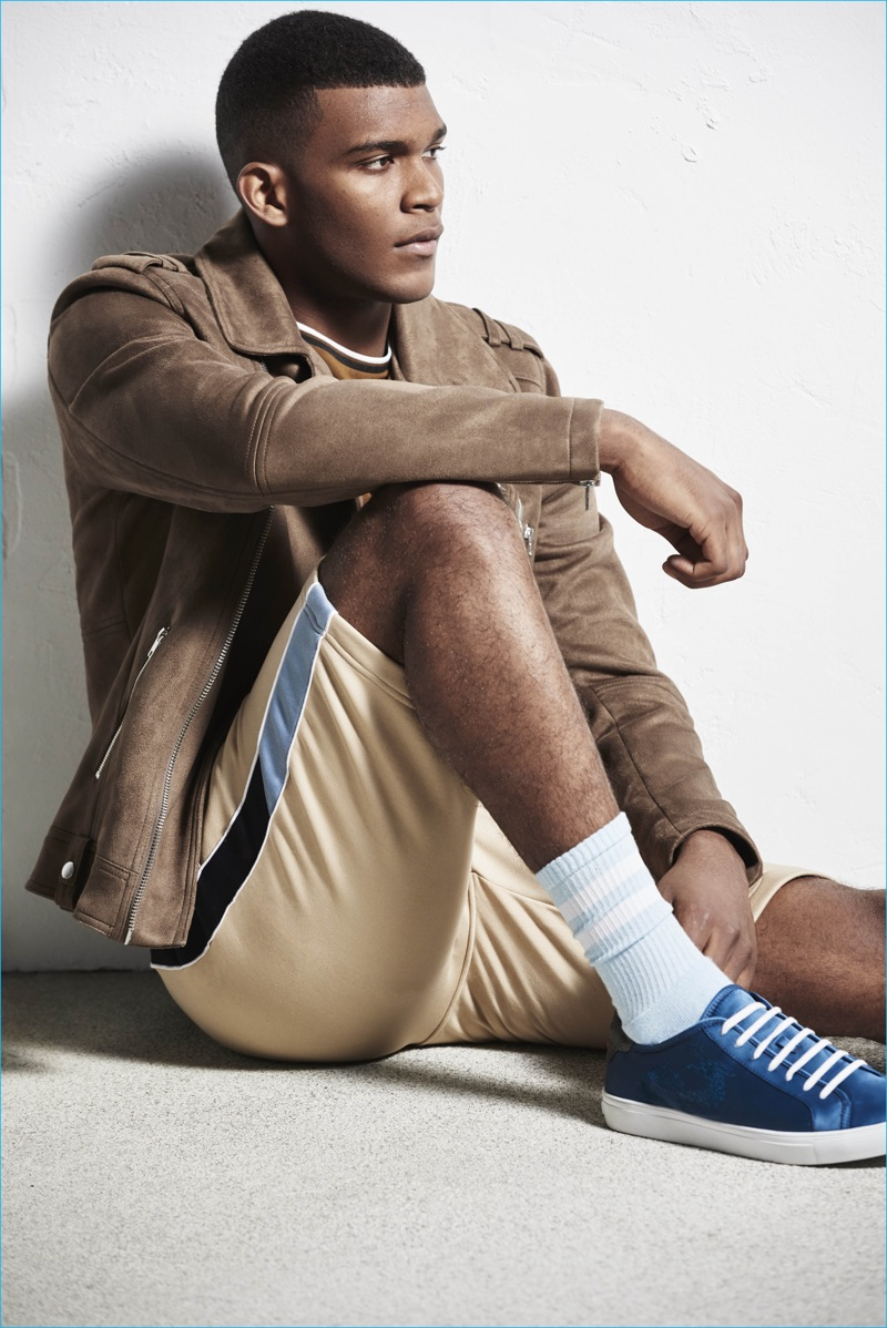 A suede jacket collides with sporty shorts for River Island's spring-summer 2017 collection.