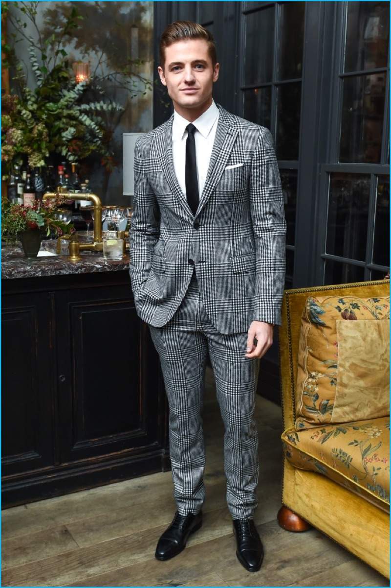 Stepping out in style, Robbie Rogers dons a two-button houndstooth suit.