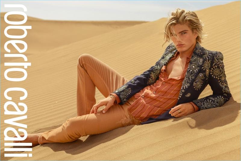 Jordan Barrett takes to the desert for Roberto Cavalli's spring-summer 2017 campaign.