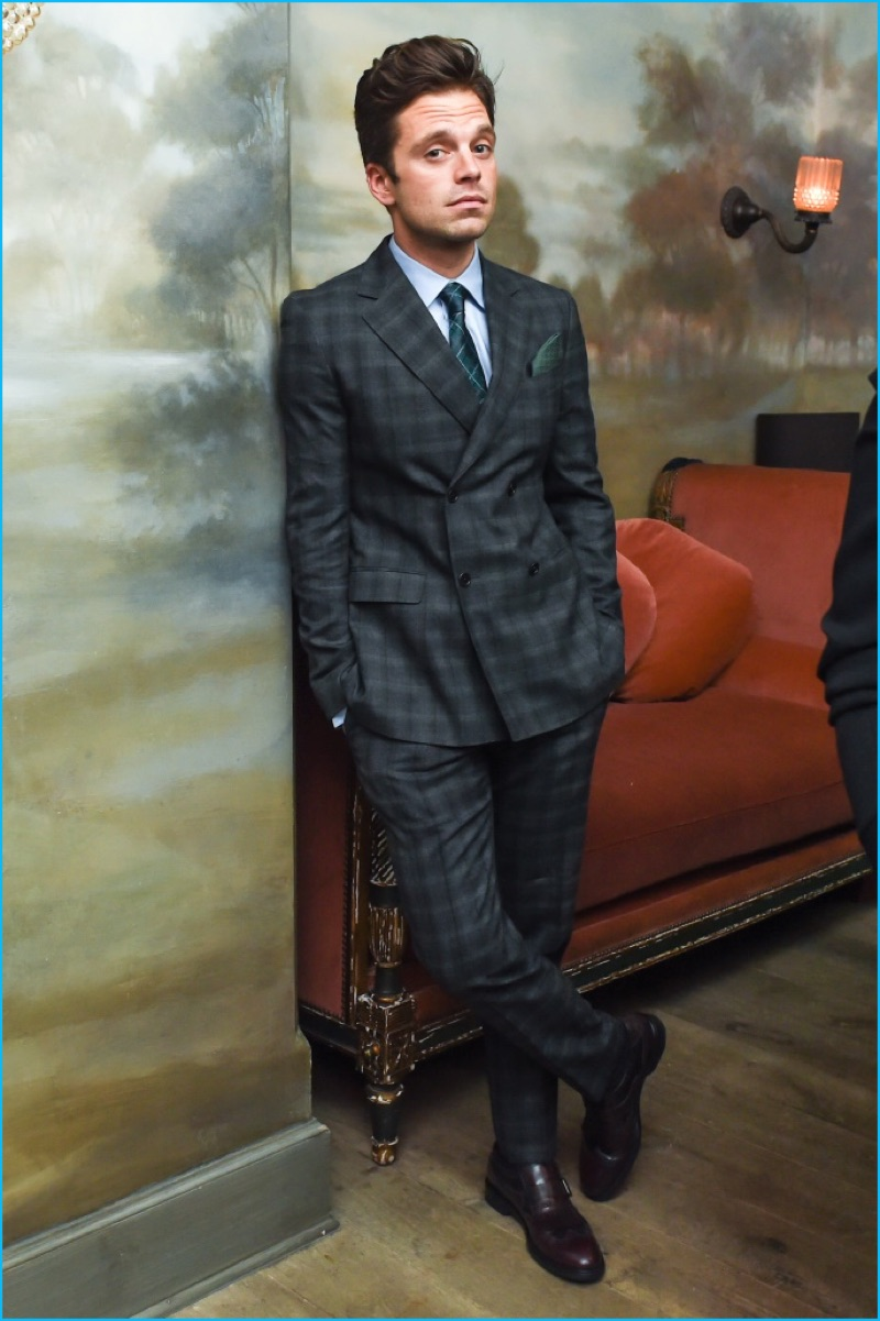 Sebastian Stan goes sartorial in a double-breasted plaid suit by Salvatore Ferragamo.