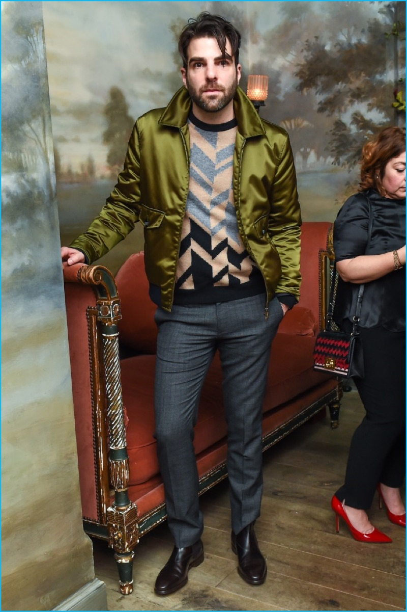 Zachary Quinto makes a style statement in a chevron sweater and satin jacket.