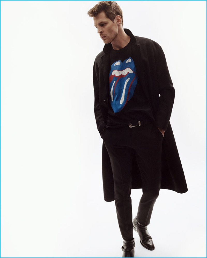 Model Adrian Wlodarski sports a printed sweatshirt from Zara's The Rolling Stones capsule collection.
