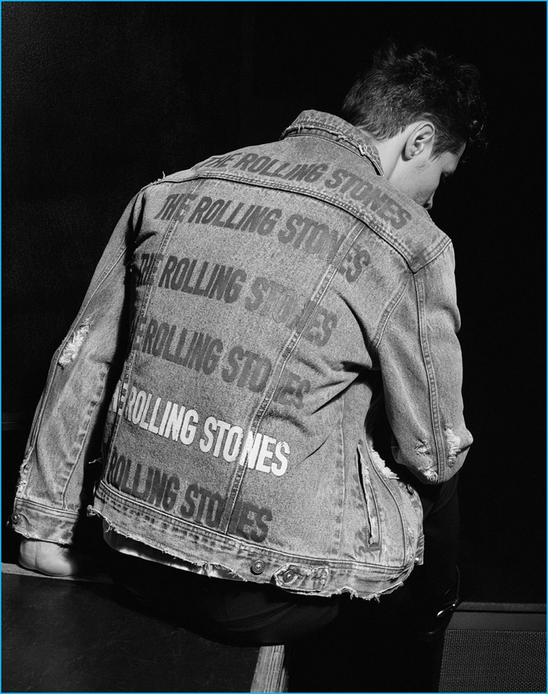 Leading model Adrian Wlodarski sports a denim jacket from Zara's The Rolling Stones capsule collection.