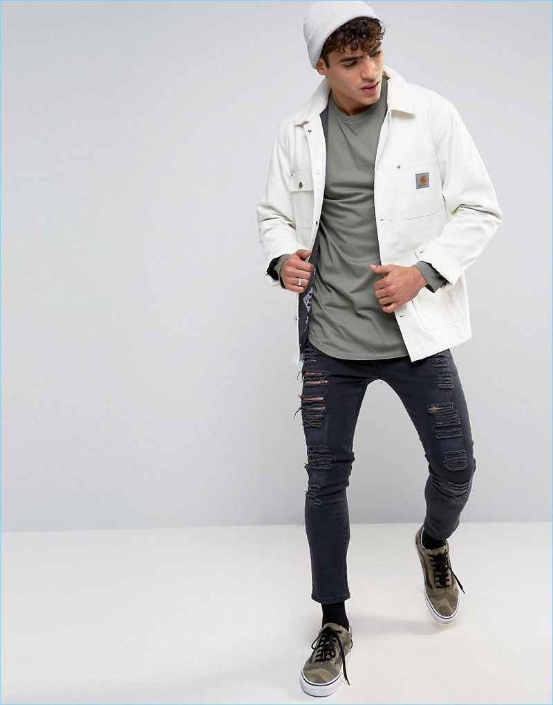 ASOS styles its longline tee with a shirt jacket and ripped black denim jeans.
