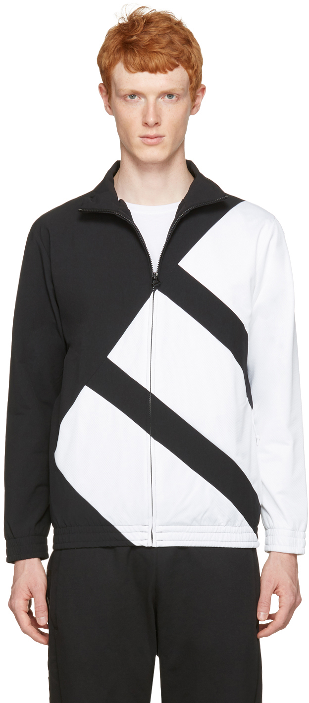 Long sleeve nylon satin and mesh track jacket colorblocked in black and white. Stand collar. Zip closure at front. Zippered seam pockets at waist. Elasticized cuffs and hem. Mesh lining. Tonal hardware. Tonal stitching. Body: 90% nylon, 10% elastane. Trim: 100% polyester. Lining: 100% polyester.