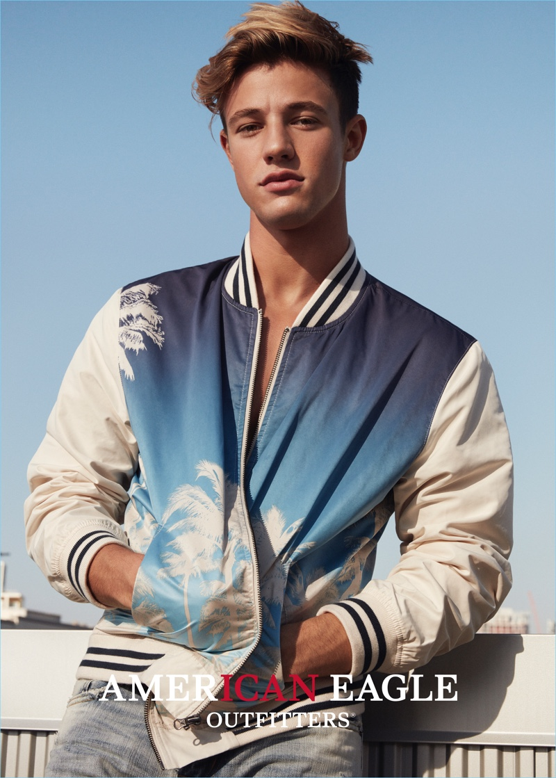 Cameron Dallas rocks a trendy bomber jacket with a palm tree print for American Eagles Outfitters' spring 2017 campaign.