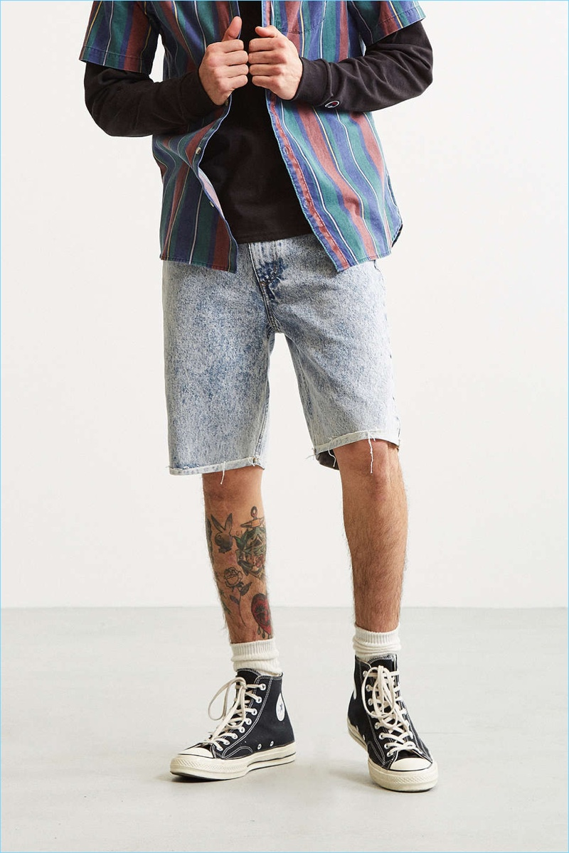 Icy acid wash shorts from BDG, exclusively available at Urban Outfitters. 100% cotton denim is cut slim in a 5-pocket design that hits at the knee with a distressed hem, complete with a zip fly + button waist closure. BDG is our collection of essential staples that give classic fits an original twist.