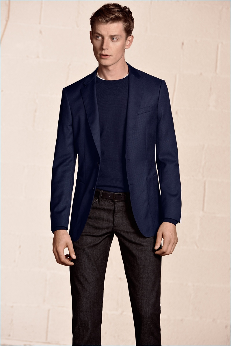 BOSS Hugo Boss enlists Janis Ancens to showcase its spring essentials, which include a navy sport coat and crewneck sweater.