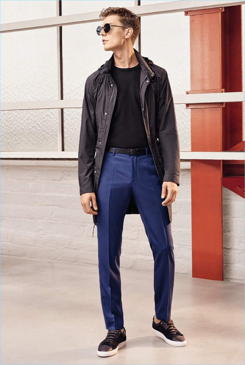 Janis Ancens is a cool vision in blue and black, wearing BOSS Hugo Boss' spring-summer 2017 travel line.