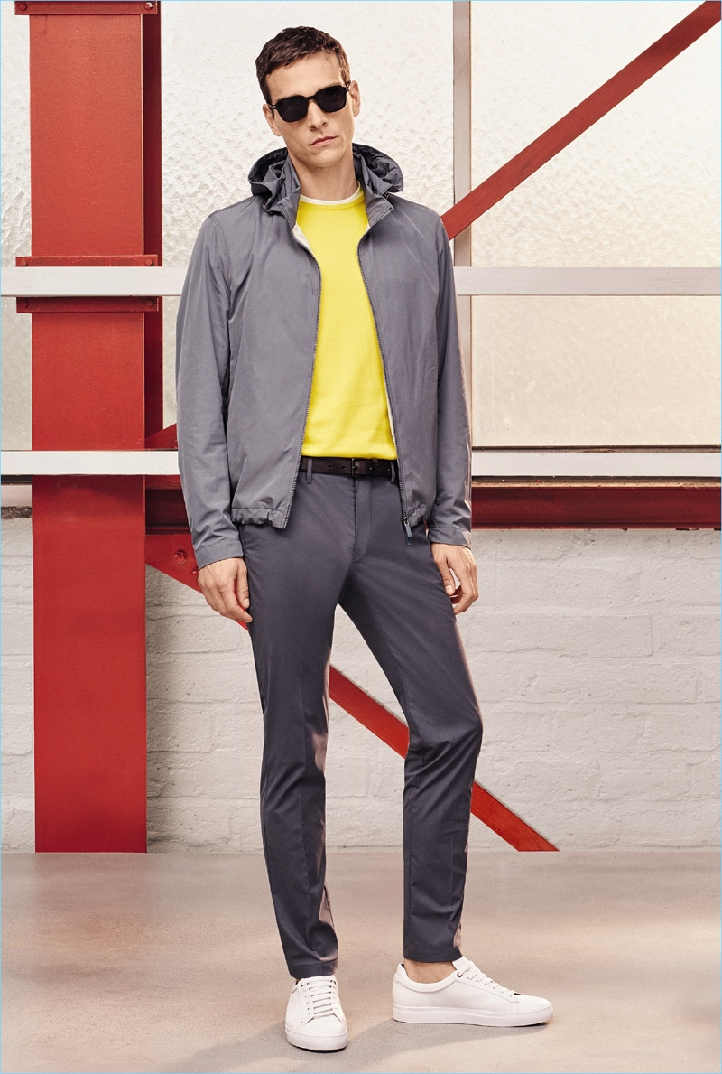 Alexandre Cunha wears a yellow and grey leisure outfit from BOSS Hugo Boss' spring-summer 2017 travel line.