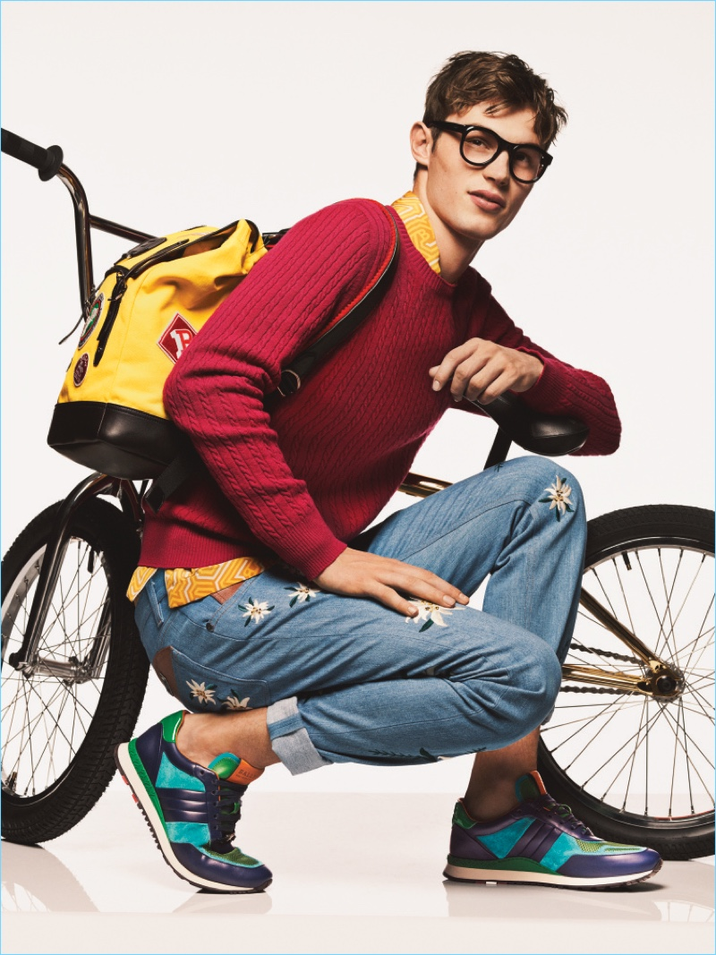Kit Butler is geek chic in a pair of glasses and colorful knitwear for Bally's spring-summer 2017 campaign.