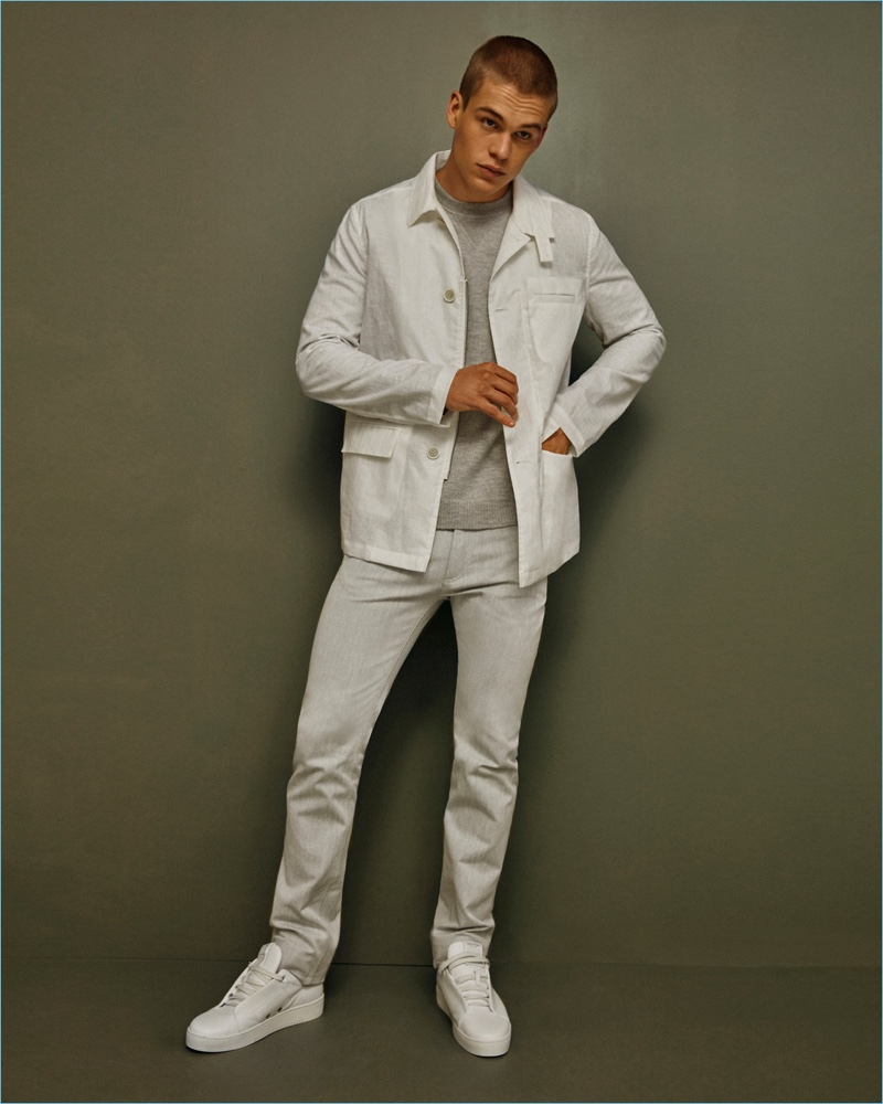 Mitchell Slaggert dons a white spring look by Calvin Klein Collection.