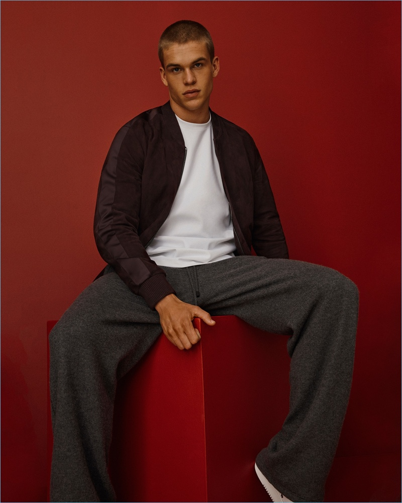 Model Mitchell Slaggert wears a suede bomber jacket with cashmere lounge pants by Calvin Klein Collection.