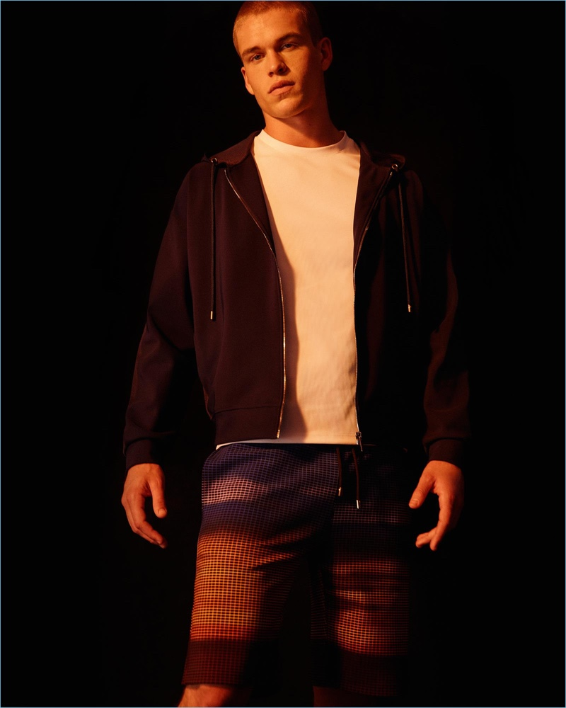 Front and center, Mitchell Slaggert sports a hoodie and graphic pants from Calvin Klein Collection.