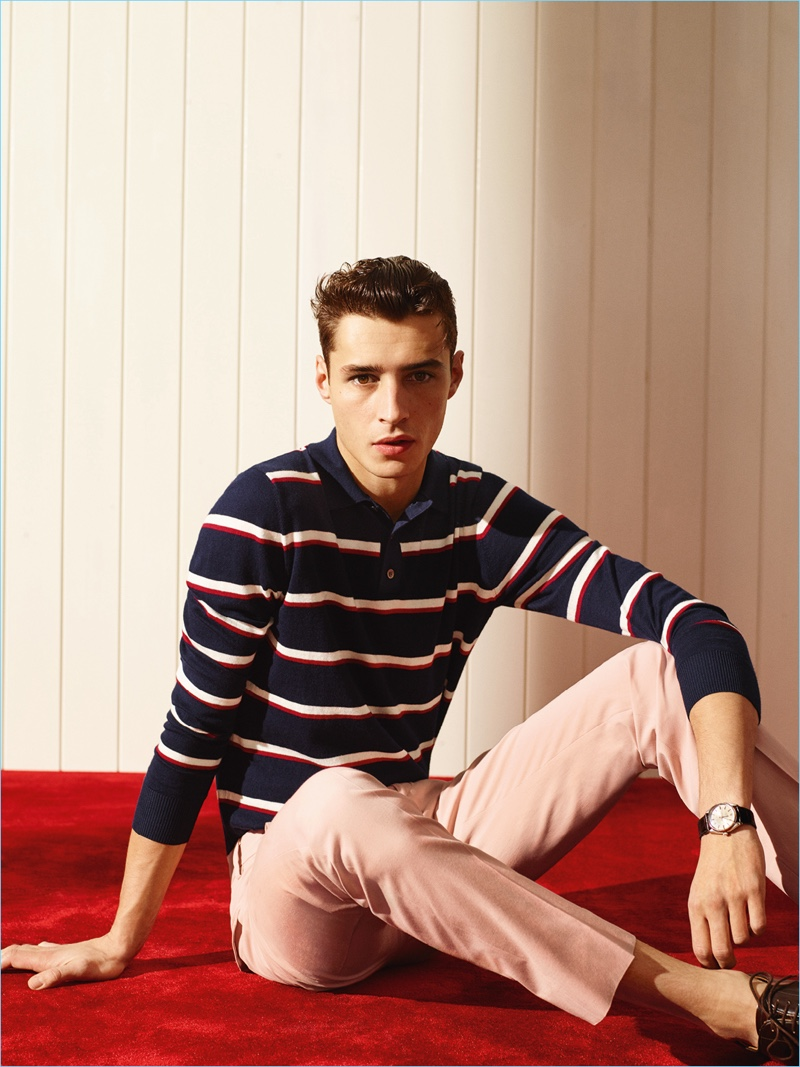 Karim Sadli photographs Adrien Sahores in a striped red, white and navy blue long-sleeve polo shirt.