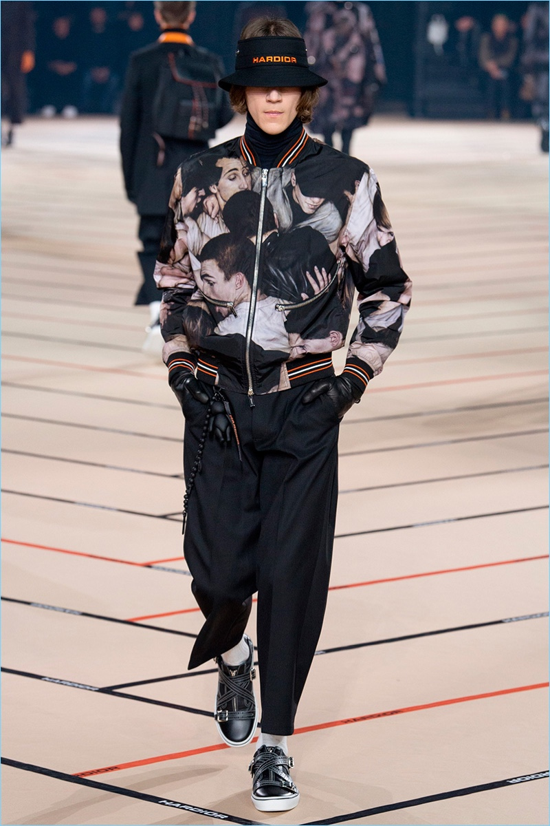 Kris Van Assche looks to raves as an inspiration for Dior Homme's fall-winter 2017 collection.