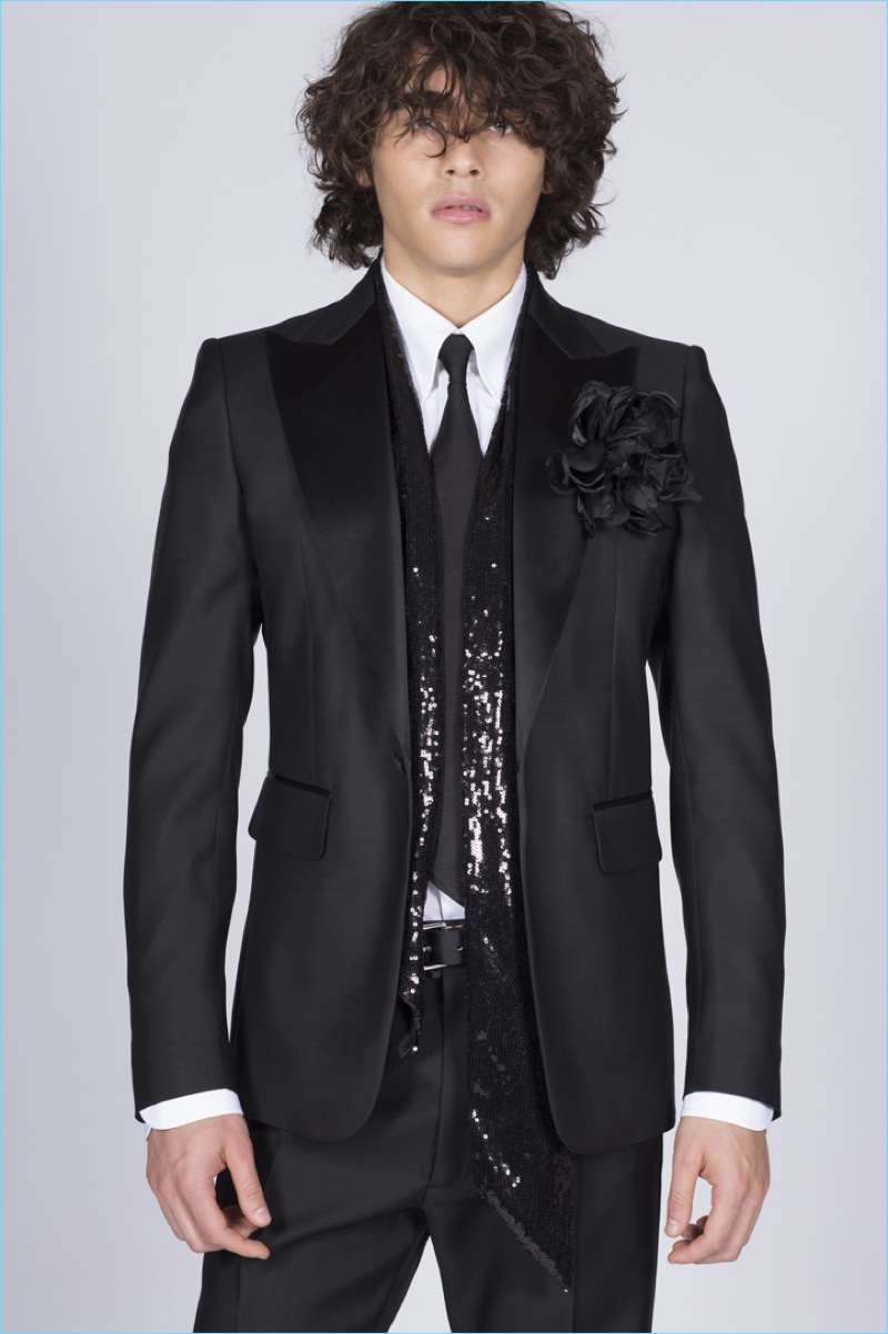 Model Francisco Perez is glam in a black tuxedo with a sequined scarf from Dsquared2.