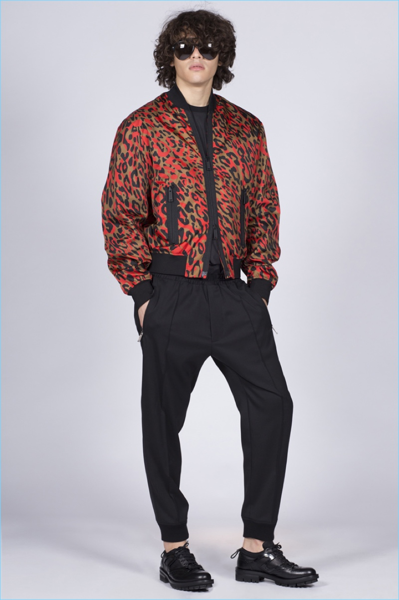 Front and center, Francisco Perez dons a leopard print bomber jacket by Dsquared2.