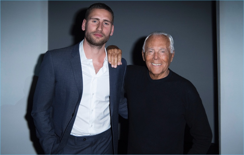 Actor Edward Holcroft poses for pictures with Giorgio Armani.